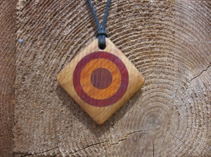 Pendant made from salvaged burr oak, purple heart, yew and